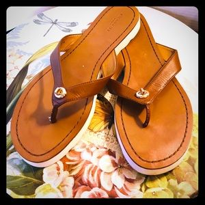 COACH leather flip flops.